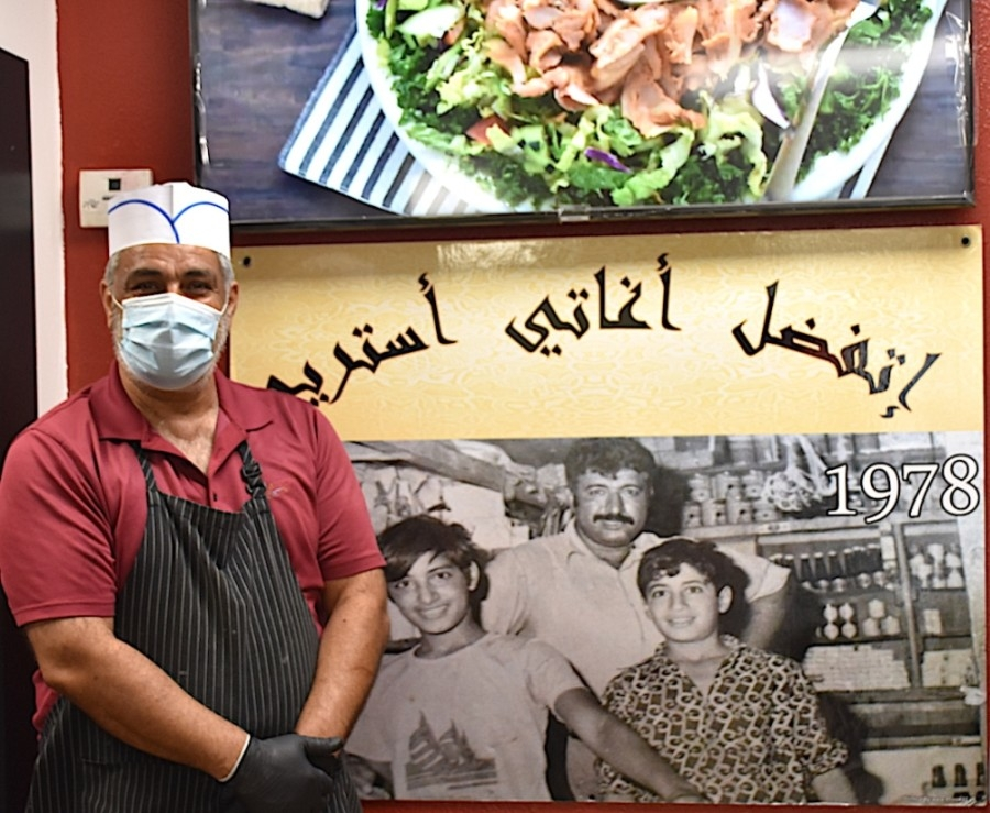 Growing up, Fuad Aldawyma helped his father and brother run the original Bilad Bakery, Restaurant & Grocery in Iraq. (Makenzie Plusnick/Community Impact Newspaper)