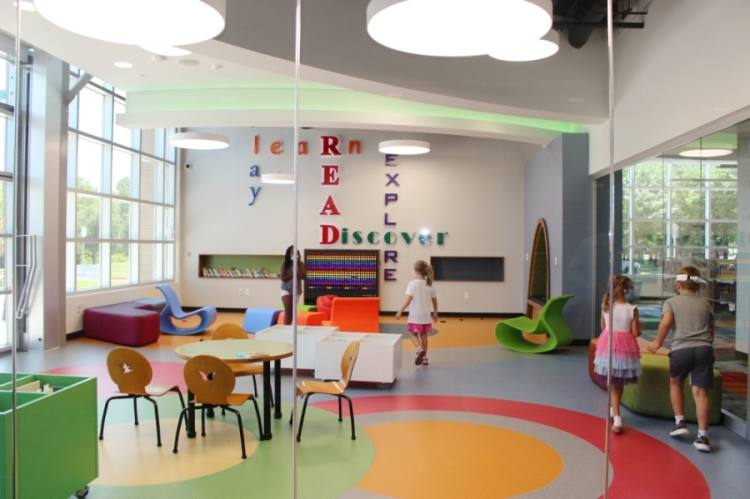 The toddler room at the library includes board books and a Lite Brite wall. (Miranda Jaimes/Community Impact Newspaper)