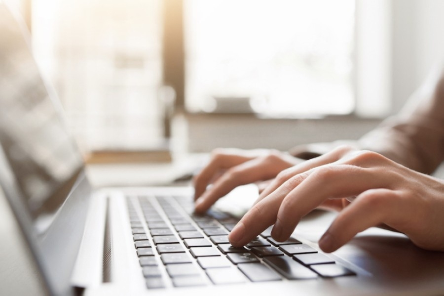 According to the district, tablet computers will be required for ninth-grade coursework in the upcoming school year. (Courtesy Adobe Stock)