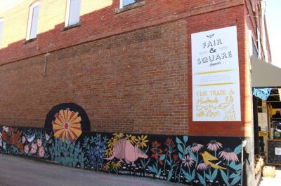 A mural depicting Texas nature and wildlife is now on the wall of Fair & Square Imports in downtown McKinney. (Miranda Jaimes/Community Impact Newspaper)