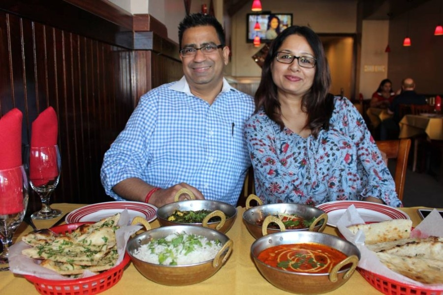 Deepak and Ritu Nagpal, owners of Indian restaurant Kurry Walah, sit at a table at the eatery's Katy location. (Nola Z. Valente/Community Impact Newspaper)
