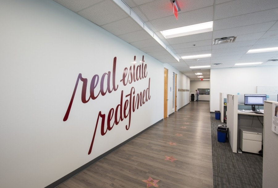 The real estate brokerage opened its Frisco office at Hall Park in June 2019. (Courtesy Redfin)