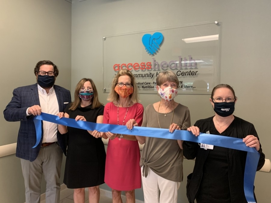 From left: AccessHealth CEO Michael Dotson; Suzy Morton, chief of Fort Bend County District Attorney's Office Child Abuse Division; Ruthanne Mefford, CEO of Child Advocates of Fort Bend; CAFB Board President Betty Baitland; and Sandra Sanchez, director of the Harris Health System Forensic Nursing Program, are pictured at the opening of the new clinic. (Courtesy Child Advocates of Fort Bend)