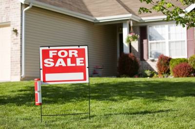 """Photo of a """"for sale"""" sign in front of a house"""
