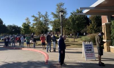 Voters keep a distance of six feet while waiting in line to cast their ballot in Grapevine. (Sandra Sadek/Community Impact Newspaper)