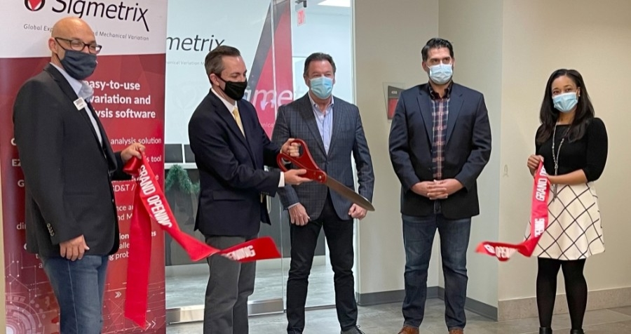 Officials with Sigmetrix and the McKinney Economic Development Corp. cut the ribbon at the company's new headquarters in McKinney on Dec. 9. (Courtesy Sigmetrix)