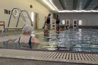 Seniors participate in a socially distanced water aerobics class at The REC of Grapevine on Nov. 17. Senior programs have slowly begun returning to in-person classes in a limited capacity. (Sandra Sadek/Community Impact Newspaper)