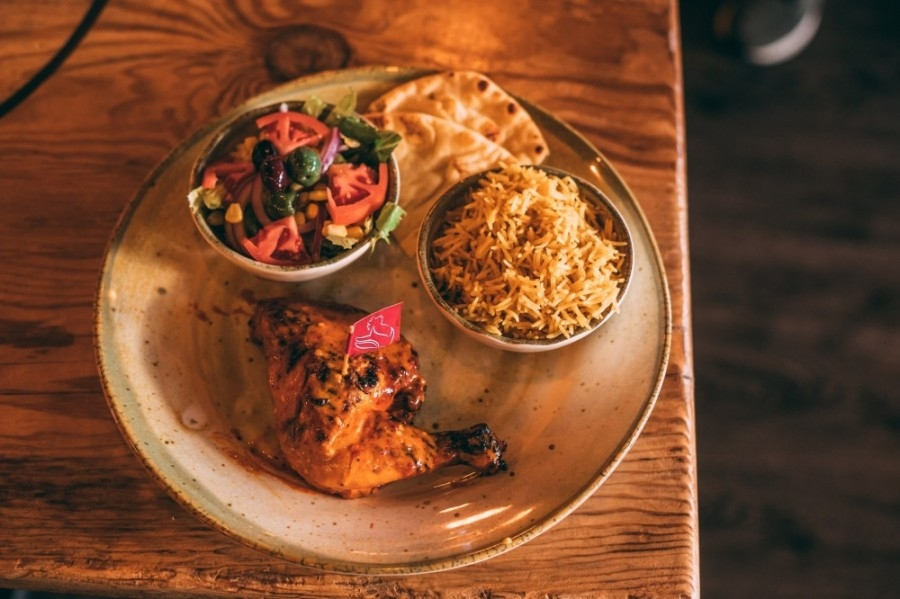 The eatery is known for its open-flame grilled chicken basted with its signature sauces made from African bird's eye chilies mixed with fresh herbs and spices. (Courtesy The Port of Peri Peri)