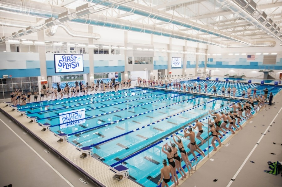 Northwest ISD swimmers jump into the Aquatic Center's competition pool for the first time Jan. 6. (Courtesy Northwest ISD)