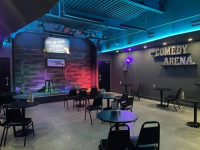 Comedy club with colored lights and socially distant seating