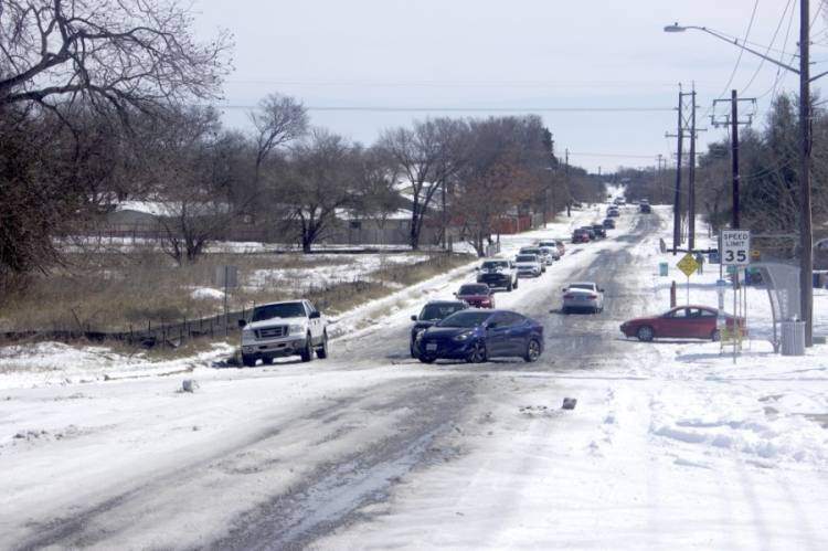 Traffic backed up on 51st Street in East Austin after a car was unable to pass through icy conditions. (Jack Flagler/Community Impact Newspaper)