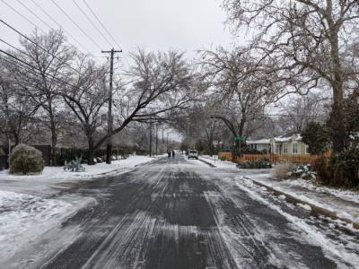 A residential road in Central Austin remains covered in snow and ice as of the morning of Feb. 17. (Iain Oldman/Community Impact Newspaper)
