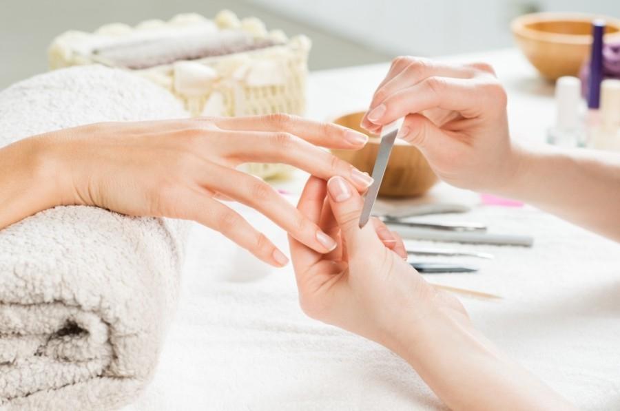 A person filing nails at a salon