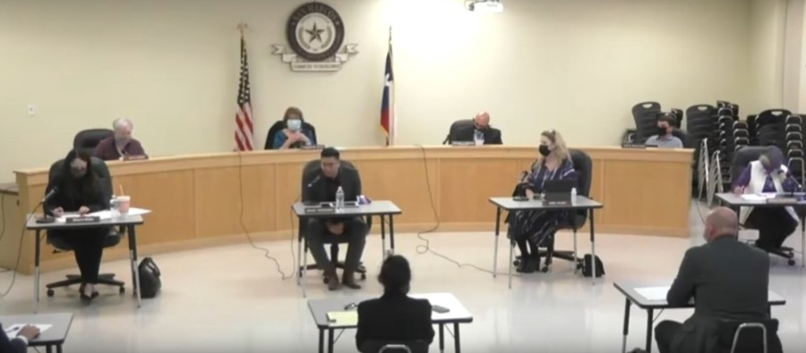 San Marcos CISD District 1 board trustee Miguel Arredondo (center left forefront) addressed the board during a March 8 meeting. (Screen shot courtesy SMCISD)
