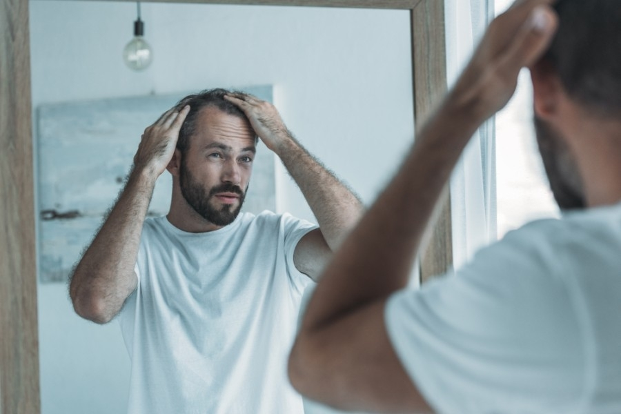 Hair Enhancement Centers offers treatments that help with hair loss and hair growth. (Courtesy Adobe Stock)