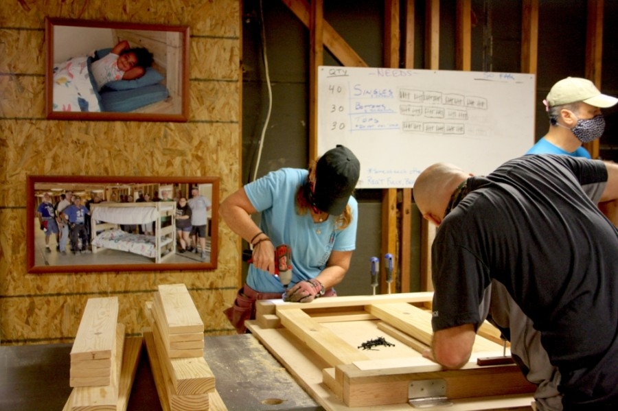 Volunteers work together to build beds for local children. (Danica Lloyd/Community Impact Newspaper)
