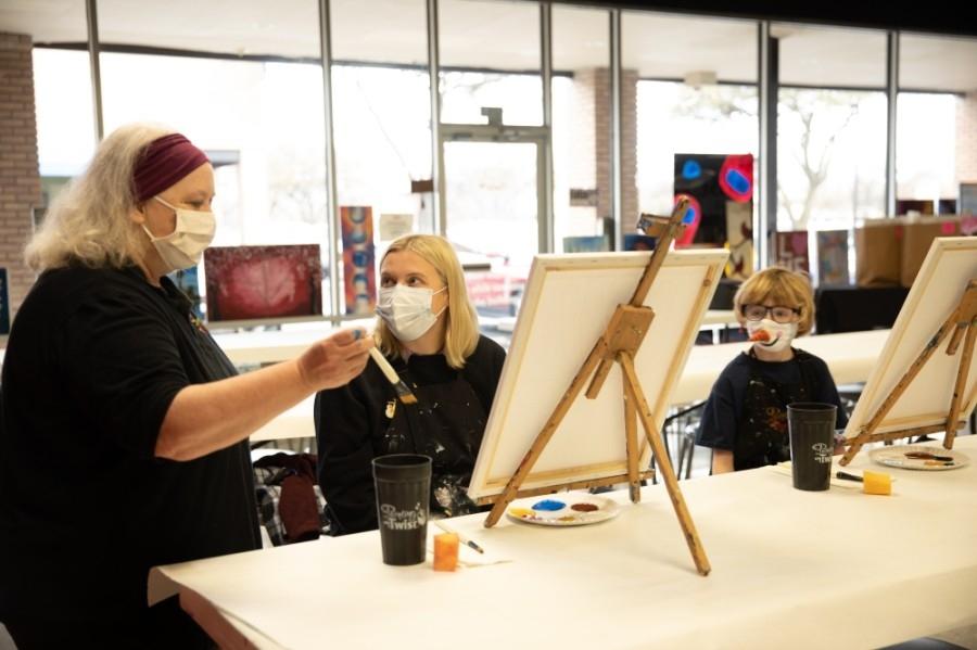 People preparing to paint.