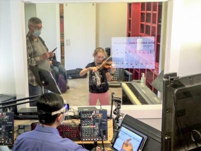 Allegro Violin School founder Chaiwat Rodsuwan is able to teach students from a separate room with the help of technology. (Courtesy Allegro Violin School)