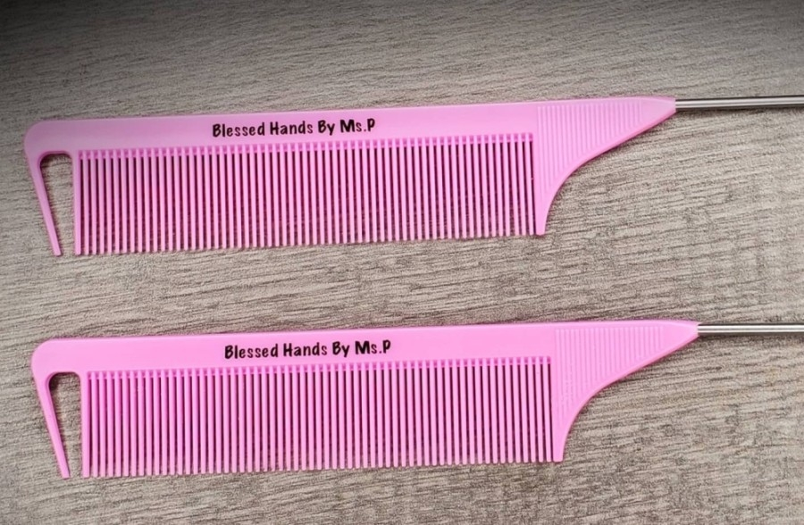 Two pink hair combs with the Blessed Hands by Ms. P logo on them