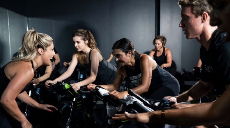 People participating in a spin class
