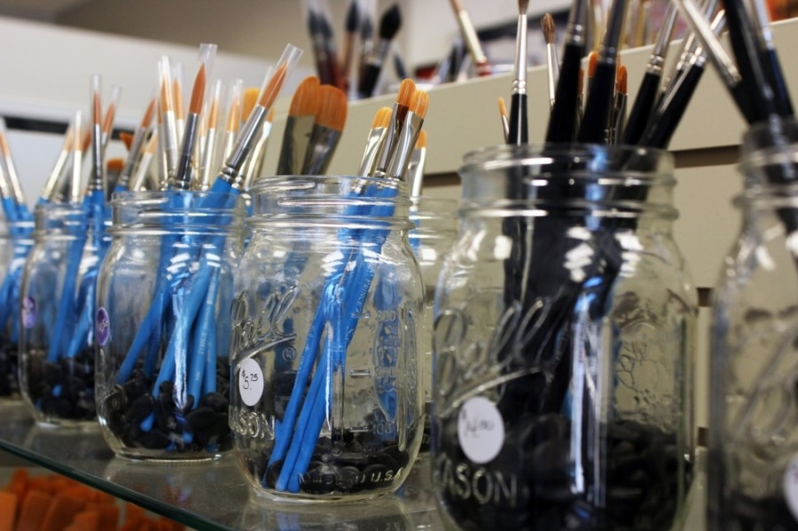 jars with paint brushes