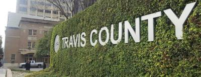 """Photo of a sign that says """"Travis County"""""""