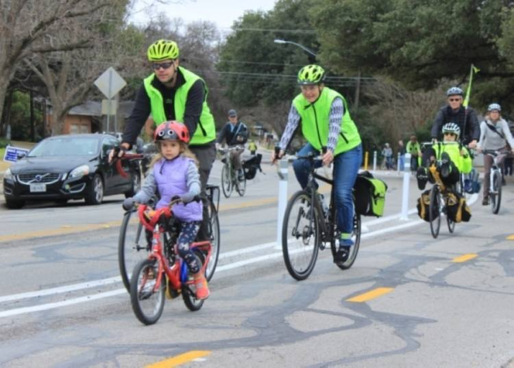 Residents ride bikes on Shoal Creek Boulevard in this photo from February 2020. Austin Water is taking on a project to replace water and wastewater lines in the Allandale neighborhood. (jack Flagler/Community Impact Newspaper)
