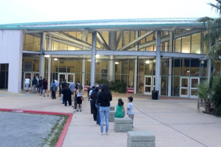 Early voting for Travis County's May 1 local elections opened April 19. In this file photo, voters line up ahead of the 2020 primary elections at Millennium Youth Entertainment Complex in East Austin. (Jack Flagler/Community Impact Newspaper)