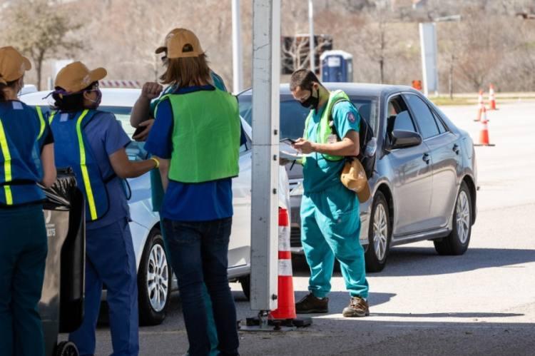 Photo of nurses offering drive-thru vaccines