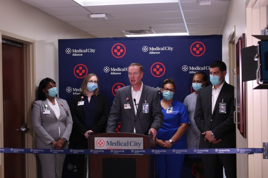 The Medical City Alliance CEO and leadership team at a podium