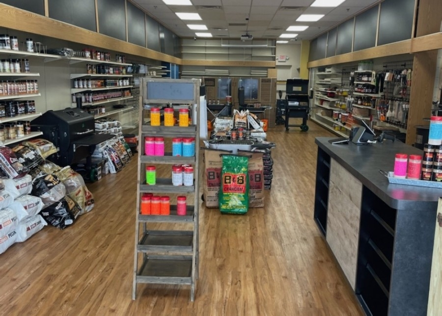 Shelves of spices and stacks of charcoal bags inside the store