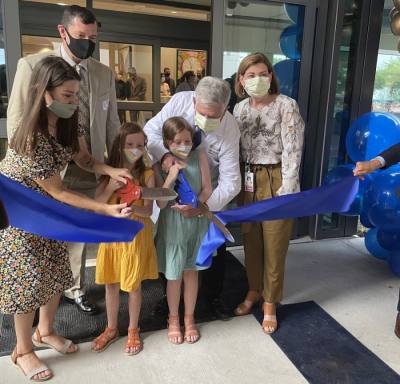 Amber Cessac (left) and her daughters help cut the ribbon at the Dell Children's Medical Center Specialty Pavilion on April 29. (Nicholas Cicale/Community Impact Newspaper)