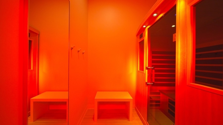 A sauna filled with red light