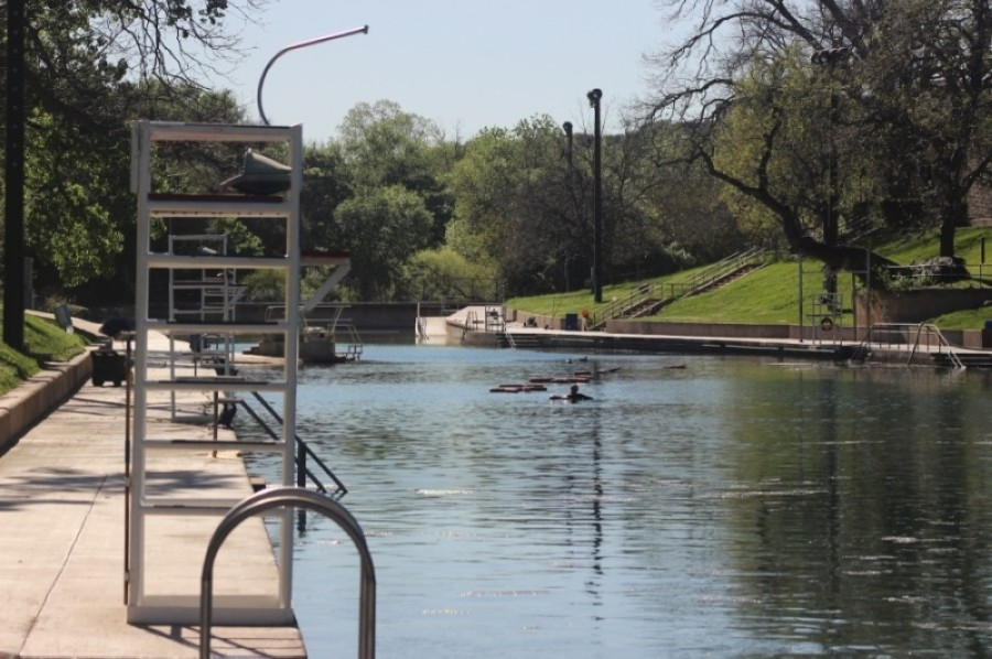Barton Springs Pool, shown here in March 2020, will require reservations for residents wishing to visit after 8 a.m. starting on May 17. (Community Impact Newspaper staff)