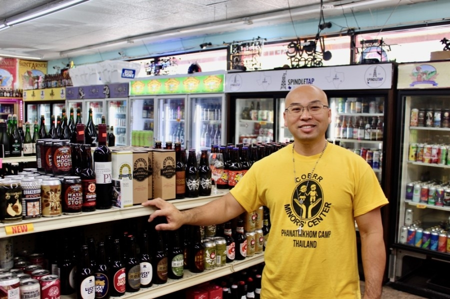 Brandon Nguyen owner of D&Q The Beer Station on Richmond Avenue, can guide overwhelmed newbies and beer veterans alike on the selections at his one-stop shop. (Matt Dulin/Community Impact Newspaper)