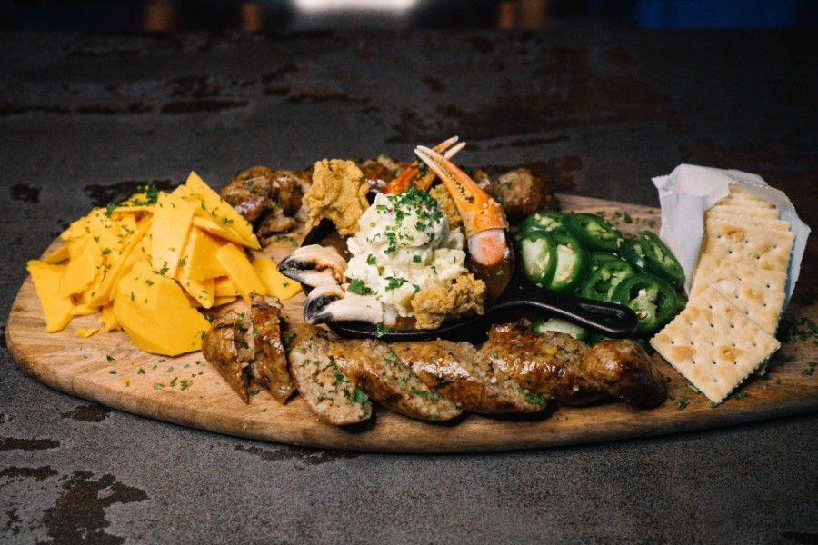 The boudin board at Studewood Grill comes with large-shred cheddar cheese and saltines. (Courtesy Studewood Hospitality)