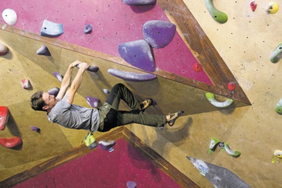 Photo of a man climbing on a rock wall