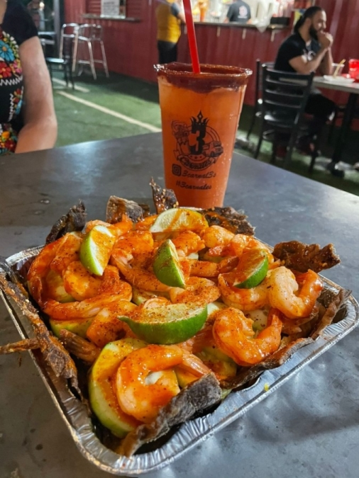 The business offers drive-thru service with micheladas, snacks, fountain drinks, and draft and bottle beers as well as food trucks. (Courtesy Tres Carnales)
