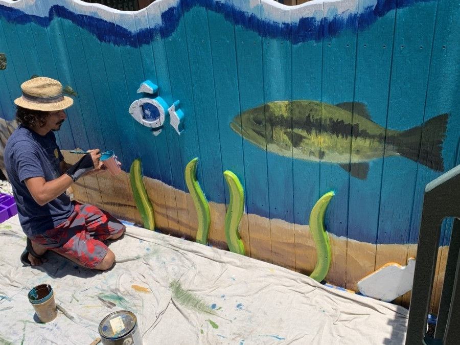 Local artist J. Rene Perez is adding numerous artistic improvements to the play area at San Marcos' Children's Park. (Photos by Heather Demere)