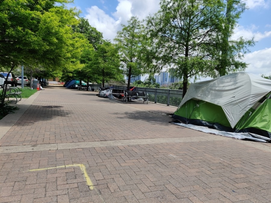 Tents and encampments lined Cesar Chavez Street downtown following Proposition B's passage in May. (Ben Thompson/Community Impact Newspaper)