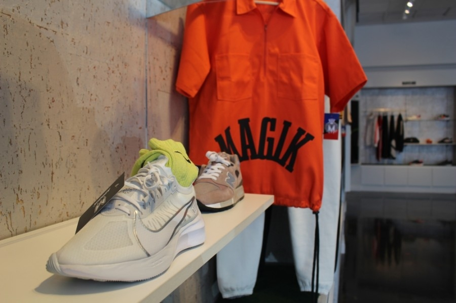 Magik's in-house clothing brand offers unisex pieces. (Amy Rae Dadamo/Community Impact Newspaper)