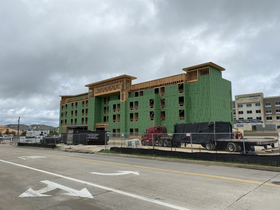 The new hotel is under construction in the Stone Hill Town Center. (Trent Thompson/Community Impact Newspaper)