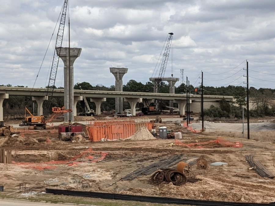 Columns are being constructed for the four flyovers linking Hwy. 249 and the Grand Parkway, and utilities are being adjusted. This image was taken in February. (Anna Lotz/Community Impact Newspaper)