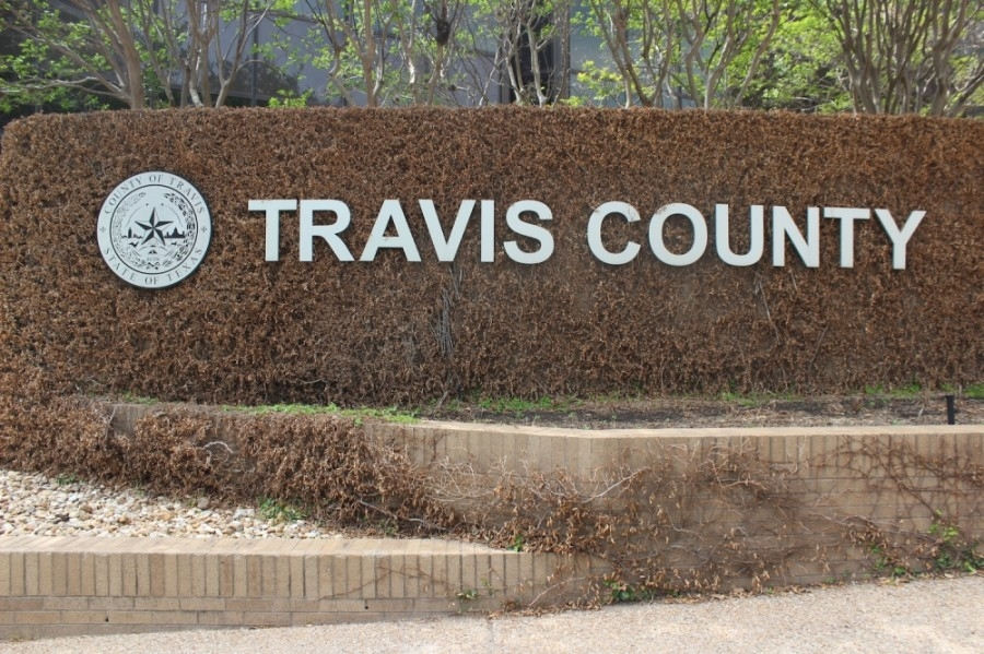 Photo of a Travis County sign