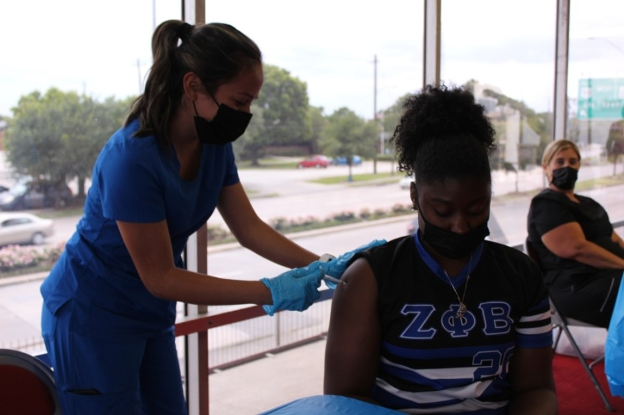A woman receives a coronavirus vaccine at a vaccination event in Houston. (Shawn Arrajj/Community Impact Newspaper)