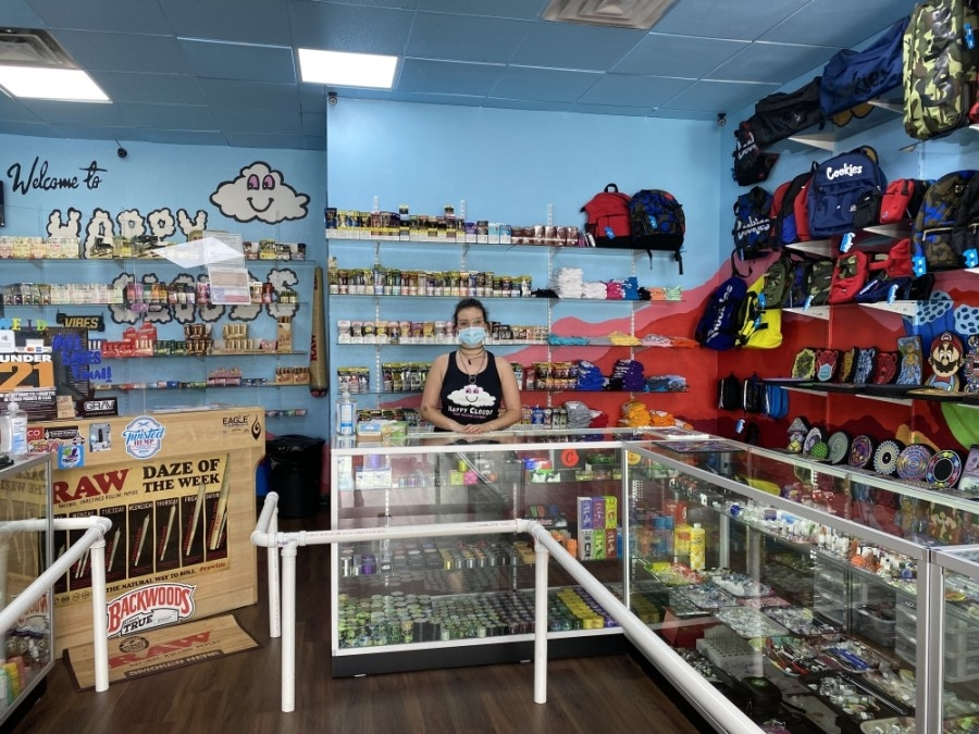 Happy Cloud Sales Associate Justice Marquez said the smoke shop opened its location on McNeil Road on April 9. (Brooke Sjoberg/Community Impact Newspaper)