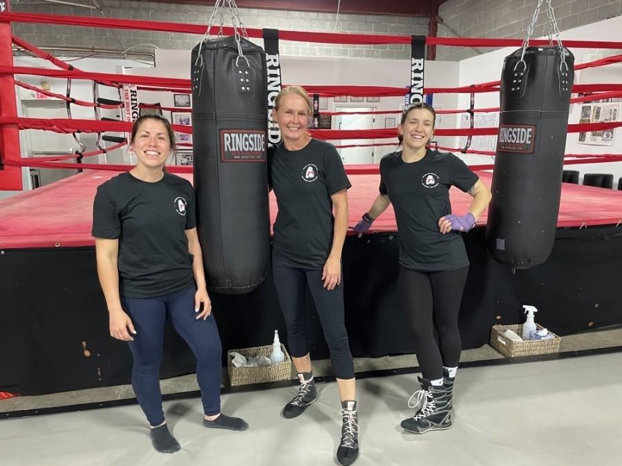 Austin Women's Boxing Club Owner Julia Gschwind (center) stands with instructors Ashley Bazan (left) and Alex Plichta. (Nicholas Cicale/Community Impact Newspaper)