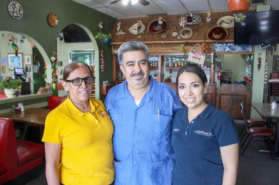 From left: Sebastiana and Jose 'Juan' Ramirez and Daisy Salinas run Noyola's Mexican Restaurant. (Kelly Schafler/Community Impact Newspaper)