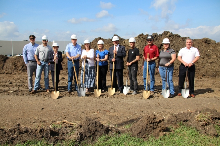 Andrew Cook, vice president of sales and marketing (fourth from left), stands next to President and CEO Kim Cook. The couple broke ground on the 42,000-square-foot office, showroom and distribution center May 27. (Megan Cardona/Community Impact Newspaper)