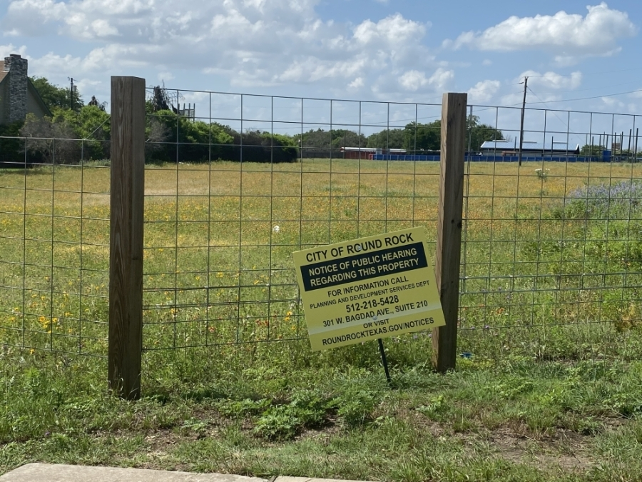 Council members voted unanimously to approve the rezoning, which will change the Camp Doublecreek property from C-1 commercial and SF-2 single family residential to a planned use development, which has the potential capacity to add 300 more residential units to the city. (Brooke Sjoberg/Community Impact Newspaper)
